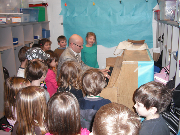 Dr. Tom Leonard Playing Piano for Students - Courtesy of Barrington Community School District 220