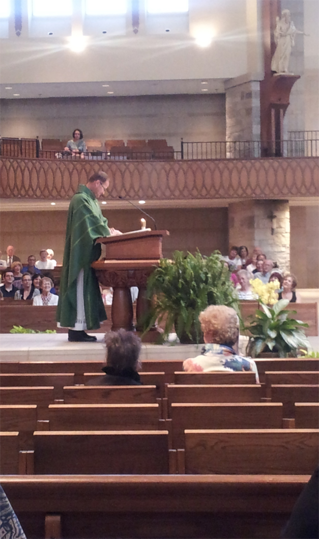 Father Chris speaks from the ambo of St. Anne's Church in Barrington. Photo courtesy of Karen McBride.