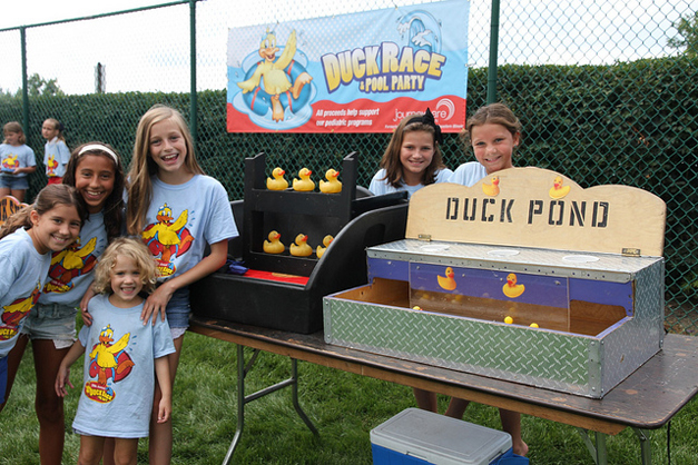 Lots of smiles at Journeycare's Duck Races & Pool Party! Photo courtesy of Bob Lee.