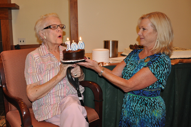 Betty Catlin Blows out the Candles on her 100th Birthday Cake at The Garlands of Barrington
