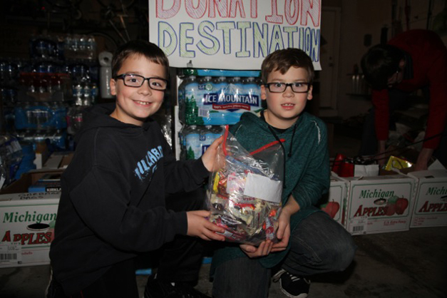 John and Connor Reilly donated their Halloween candy to the Gadbois Family's tornado relief efforts - Photographed by Bob Lee