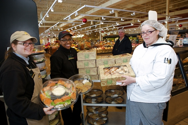 Vie Squires and deli department colleagues bring out Paul Dietzen's catering order - Photographed by Julie Linnekin