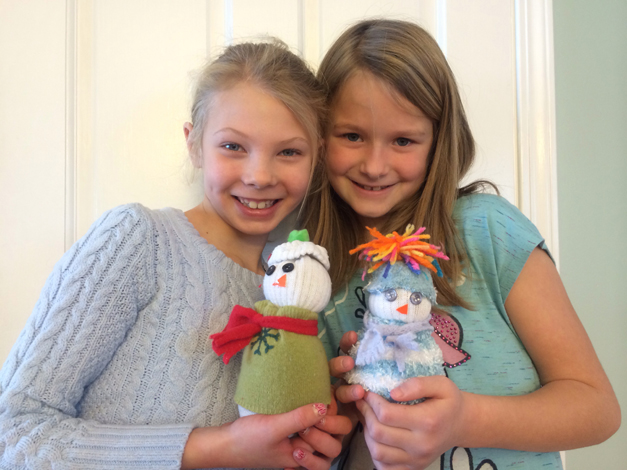 Jenna Kerr and Anastasia Loppnow showing their cute sock snowmen creations - Photo Submitted by Laura Loppnow