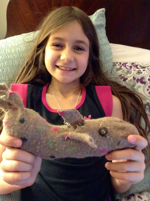 This is Amy holding her whale that she cut and sewed all by herself using material from one of her mom's old socks. Made today, 1/6/14 - Submitted by Amy Olsen