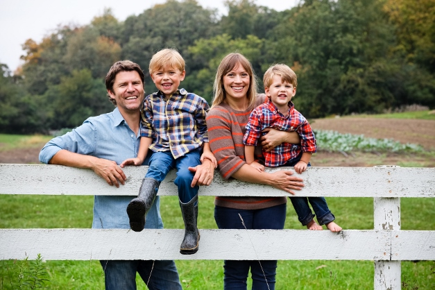 Dominic and Jessica Green at the farm with their boys Henry and Oliver - Photograph courtesy of Christina Noel
