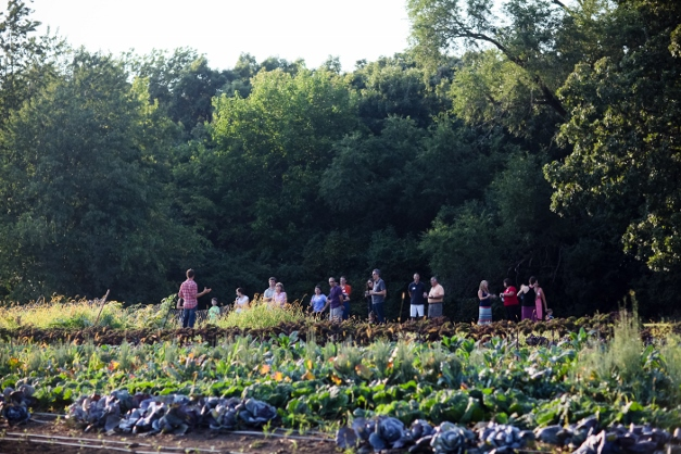 Dominic leads a field tour during a summer picnic for CSA members - Photograph courtesy of Christina Noel Photography