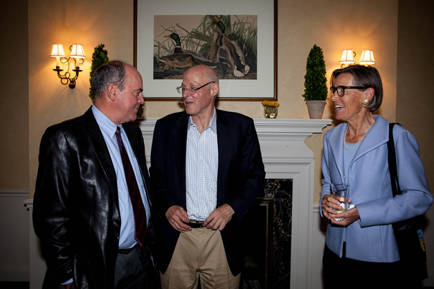 Former US Secretary of the Treasury, Hank Paulson, and his wife, Wendy, visit with a guest during a private dinner in his honor at Barrington Hills Country Club - Photo by Liz Benedetto, Elizabeth Ashby, Inc.