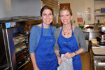 Jennifer Kainz and Julie Baily baking in the JourneyCare kitchen - Photograph by Liz Luby